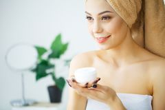 Beauty Face Care. Woman Applying Cream On Skin. Beauty Face Care. Woman Applying Cream On Skin Stock Photography