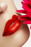 Beauty face closeup. lips. Beauty red lip makeup detail. Beautiful make-up close-up royalty free stock photo