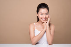 Beauty face. Facial treatment. Young asian woman with clean perfect skin touch her face. royalty free stock images