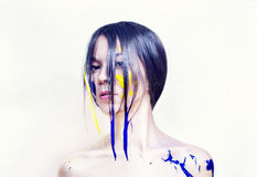 Beauty face of girl painted blue and yellow Royalty Free Stock Image