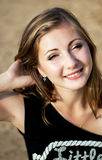 Beauty face of happy smiling woman in yellow sunny beach Royalty Free Stock Photos