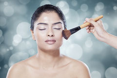 Beauty face with makeup brush Stock Images