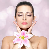 Beauty Face Of Pretty Woman With Flower. Beauty Treatment Concept. Royalty Free Stock Images