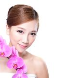 Beauty  face with orchids Royalty Free Stock Photo