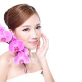Beauty  face with orchids Royalty Free Stock Image