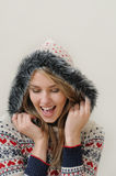 Beauty face portrait of attractive smiling woman in warm clothin Royalty Free Stock Image