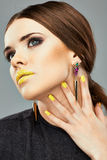 Beauty face portrait . Lips, Nails Yellow. Royalty Free Stock Photos
