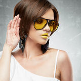 Beauty face portrait of sexy model with yellow sun glasses. Royalty Free Stock Photography