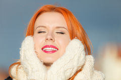 Beauty face red hair woman in warm clothing outdoor Royalty Free Stock Image