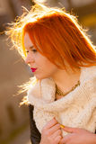 Beauty face redhaired woman in warm clothing outdoor Stock Photo