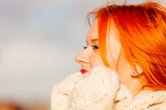 Beauty face redhaired woman in warm clothing outdoor Stock Image