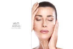 Beauty Face Spa Woman. Surgery and Anti Aging Concept. Head shot of beautiful model with hands on face and closed eyes with a serene expression suitable for anti royalty free stock photos