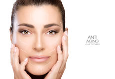 Beauty Face Spa Woman. Surgery and Anti Aging Concept. Anti aging treatment and plastic surgery concept. Beautiful young woman with hands on cheeks and a serene royalty free stock image