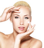 Beauty face of woman applying cosmetic cream on face Royalty Free Stock Photo