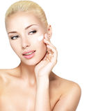 Beauty face of woman applying cosmetic cream on face Royalty Free Stock Photos