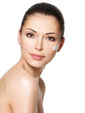 Beauty face of woman with cosmetic cream on face Stock Photos
