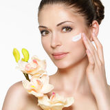 Beauty face of woman with cosmetic cream on face Royalty Free Stock Photography