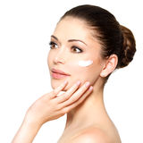 Beauty face of woman with cosmetic cream on face Stock Images