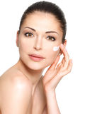 Beauty face of woman with cosmetic cream on face Royalty Free Stock Images
