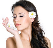 Beauty face of woman with flowers Stock Photography