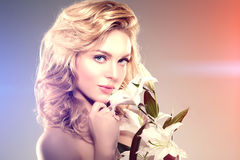 Beauty face woman, flowers, lily. Girl healthy model in spa salo Royalty Free Stock Photo
