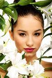 Beauty face of a woman with flowers. Stock Photo