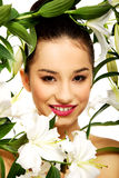 Beauty face of a woman with flowers. Royalty Free Stock Photos