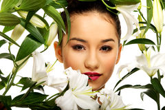 Beauty face of a woman with flowers. Royalty Free Stock Images