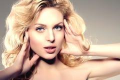 Beauty face woman. Girl healthy model in spa salon. Cream treatm Stock Image