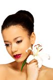 Beauty face of woman with lily flower. Stock Photo