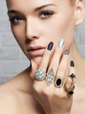 Beauty face.woman& x27;s hands with jewelry rings Royalty Free Stock Images