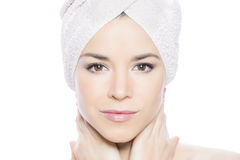 Beauty face. Woman in a beauty shot with a towel around her head Stock Images