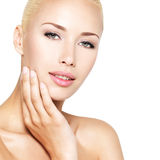 Beauty face of the young beautiful blond woman Stock Photos