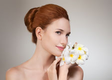 Beauty face of young beautiful woman with flower. Stock Image