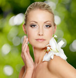 Beauty face of young beautiful woman with flower royalty free stock images