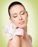 Beauty face of young beautiful woman with flower Stock Photography