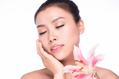 Beauty face of young beautiful woman with flower Royalty Free Stock Image