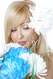 Beauty face of the young beautiful woman with flower Stock Images