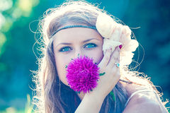 Beauty face of the young beautiful woman with flower. Portrait of a beautiful girl with a flower Royalty Free Stock Images