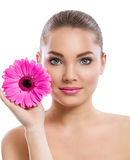 Beauty face of the young beautiful woman with flower Stock Image