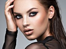 Beauty face of the young beautiful woman stock images