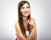 Beauty face. Young model holding make up brush. Young beauty wo Royalty Free Stock Photo