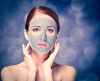 Young redhead woman with cosmetic cream royalty free stock image