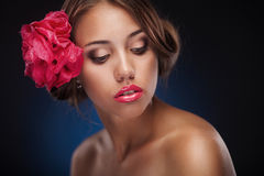 Beauty face of the young woman with flower Royalty Free Stock Photo