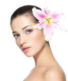 Beauty face of young woman with flower Royalty Free Stock Photo