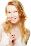 Beauty face of the young  woman with flowers Royalty Free Stock Image