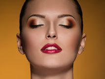 Fashion Makeup dark gold Stock Photos