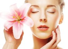 Beauty face of the young woman with pink lily Stock Photo