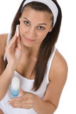 Beauty facial care - Teenager woman cleaning skin Royalty Free Stock Photos