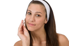 Beauty facial care - Teenager woman cleaning skin Royalty Free Stock Image